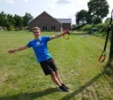 Schlingentrainer Uebung Rudern Drehung